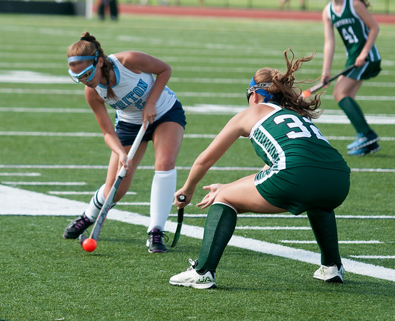 JIM VAIKNORAS/Staff photo Triton's Sofie Desimore passes the ball past Pentucket's Talia Beech during their game at Triton in Byfield Thursday.