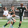 BRYAN EATON/Staff photo. Ben Lantz, center, and Jack Ancevic, right, defend against a Newburyport player.