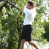 BRYAN EATON/Staff photo. Amesbury's Zach Lebrecgue tees off.