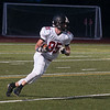 JIM VAIKNORAS/Staff photo  Marblehead's Derek Marino returns a kick off Friday at Triton.