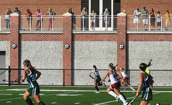 BRYAN EATON/Staff photo. Fans chose the sunny balcony at World War Memorial Stadium in Newburyport instead of the stands to watch their field hockey team host Pentucket. The weather stays sunny and warm throughout the week.