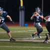 JIM VAIKNORAS/Staff photo Triton's Thomas Lapham looks downfield for a receiver against Ipswich Friday night at Triton.