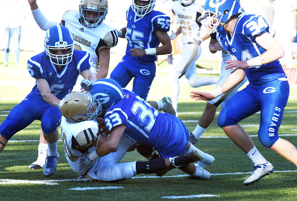 BRYAN EATON/Staff photo. The Georgetown defense takes down a Coyle and Cassidy player.