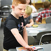 BRYAN EATON/Staff photo. Second-grader Collin Ingalls, 7, organizes his pencil box in Deborah Dennehy's room as he waits for class to start. He was at Salisbury Elementary School on Tuesday morning where classes started as well as the rest of the Triton School District and the Pentucket School District.