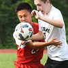 BRYAN EATON/Staff photo. Masconomet's Haolan Zahn and Ryan Gallagher fight for the loose ball.