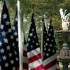 JIM VAIKNORAS/Staff photo  Flags and the Swan Sculpture at the Field of Honor ceremony on the Bartlet Mall in Newburyport Sunday afternoon.