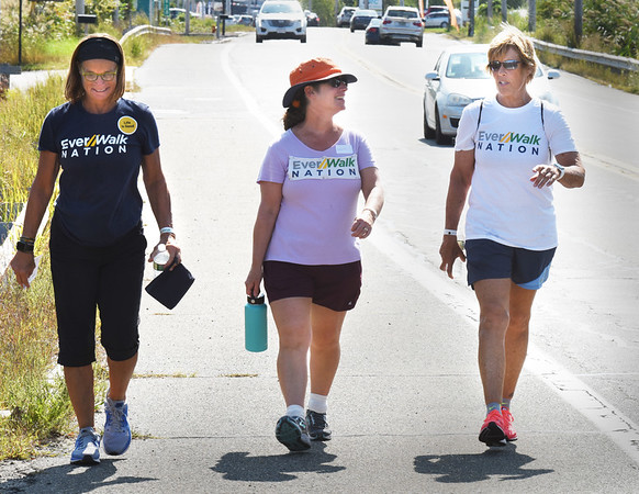 BRYAN EATON/Staff photo. Diana Nyad, right, and co-organizer of Ever Walk Bonnie Stoll, left, and Laura Petersen walk north on Bridge Road in Salisbury.