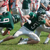 JIM VAIKNORAS/Staff photo Amesbury's Hayden Ayotte runs through Pentucket players at Pentucket high Saturday.