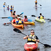 BRYAN EATON/Staff photo. Amesbury Middle School students took to kayaks and paddle boards on Lake Gardner on Thursday morning. The physical education teachers arranged for Plum Island Kayak to allow the students to have a very special gym class in the open.