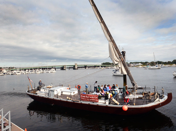 BRYAN EATON/Staff photo. The gundalow Piscataqua out of Portsmouth, N.H. motors from the Newburyport waterfront with students from the River Valley Charter School before raising its sail.