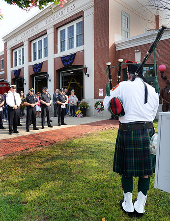 "BRYAN EATON/Staff photo. Former Amesbury fire chief William Shute plays ""Amazing Grace"" on the bagpipes at a 9/11 memorial service at the fire station Monday morning. A time of prayer and reflection was held after candles were in honor of first responders and civilians who lost their lives in the terrorist attack."
