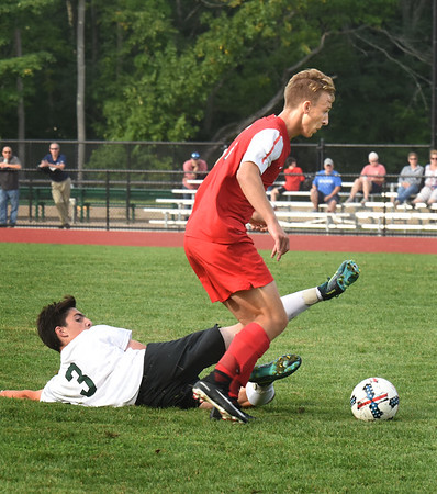 BRYAN EATON/Staff photo. Masconomet's Mike Budrewicz gets the ball from Pentucket's Jake Correnti.