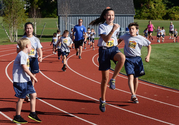 BRYAN EATON/Staff photo. Students from the Immaculate Conception School in Newburyport participate in a fun run around the track at Fuller Field on Thursday morning. They got pledges for each lap they ran with proceeds going to enrichment programs such as field trips.