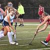 BRYAN EATON/Staff photo. Triton's Bell runs into some Everett defense.