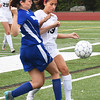 BRYAN EATON/Staff photo. Georgetown's Nicole Connelly, left, and Triton's Kyla Prussman moves after the ball.