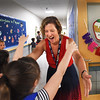 BRYAN EATON/Staff photo. First grade teacher Laura Savey greets former students as they head past her classroom to theirs on Tuesday morning at Salisbury Elementary School. It was the first day of classes for the Triton School District as well as Pentucket District Schools.