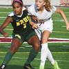BRYAN EATON/Staff photo. Newburyport's Allie Waters battles with a North Reading player.