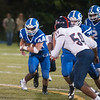 JIM VAIKNORAS/Staff photo Georgetown's Zach Beauvais takes a handoff against Lynn Tech at Georgetown Friday night.