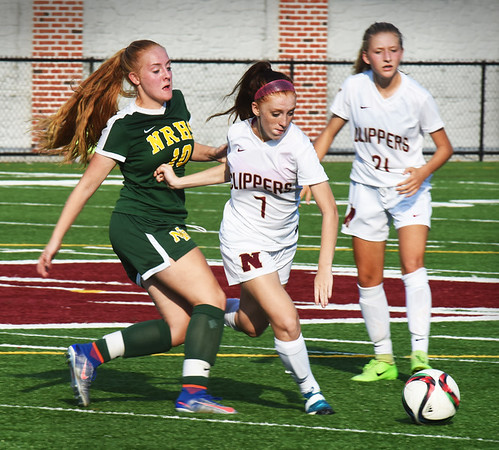 BRYAN EATON/Staff photo. Newburyport's Audra Greenbiott moves the ball.