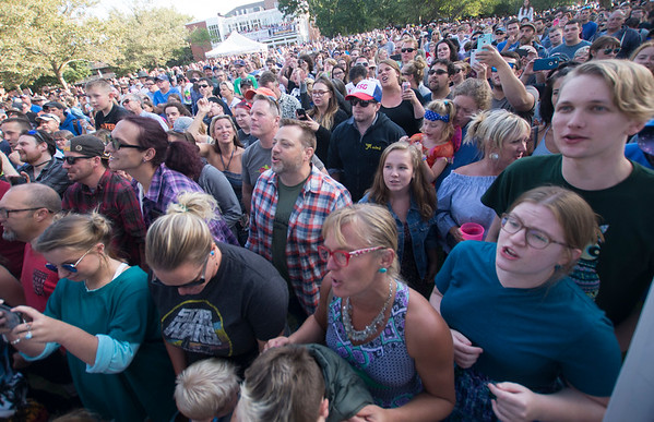JIM VAIKNORAS/Staff photo Fans stand as they listen to They Might Be Giants as they perform at the 16th Annual Newburyport Riverfront Music Festival at Market Landing Park in Newburyport Saturday. .