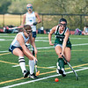 JIM VAIKNORAS/Staff photo Triton's Riane Vatcher fights for the ball with Pentucket's Sabrina Paolino during their game at Triton in Byfield Thursday.