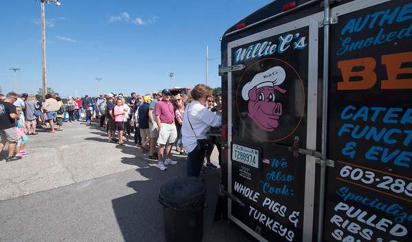 JIM VAIKNORAS/Staff photo A long line forms for Willie C's BBQ at the Fill 'em Up Fest at Cashman Park in Newburyport Saturday. The event raised money for OUr Neighbor Table in Amesbury and featured a number of food trucks and local beers.