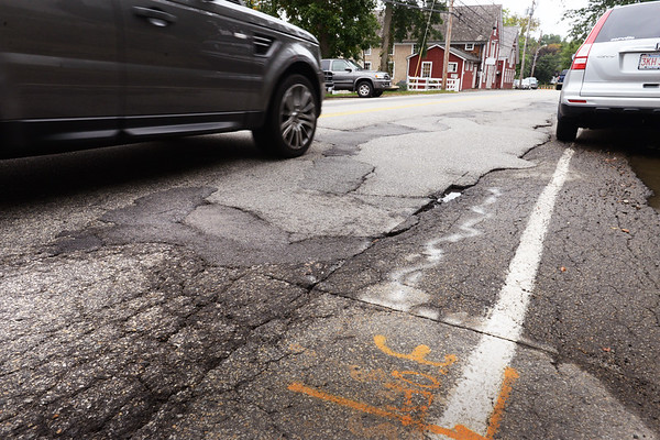 BRYAN EATON/Staff photo. Parts of Main Street in Amesbury is a hodge podge of different patches of asphalt.