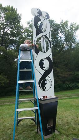 JIM VAIKNORAS/Staff photo Rochelle Perry-Platine installs her piece  at Maudsay in Newburyport.