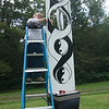 JIM VAIKNORAS/Staff photo Rochelle Perry-Platine installs her piece  at Maudsay in Newburyport.