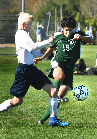 BRYAN EATON/Staff photo. Triton's #12 and mid-fielder Thomas Birkland battle it out.