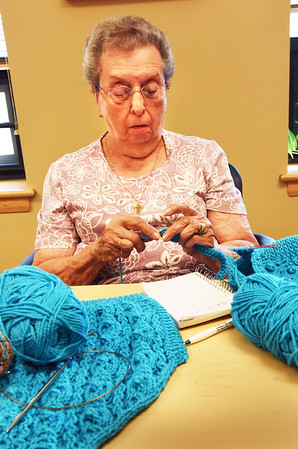 BRYAN EATON/Staff photo. Mae Kelleher of Amesbury is one of several who meet on Tuesdays for the Busy Needles group at the Amesbury Senior Center. She was making a sweater for an upcoming church fair for the Holy Family Parish.