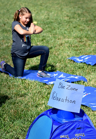"BRYAN EATON/Staff photo. Brynn Sirota, 8, does some meditation in the ""blue zone"" which is for relaxation at the Bresnahan School in Newburyport."