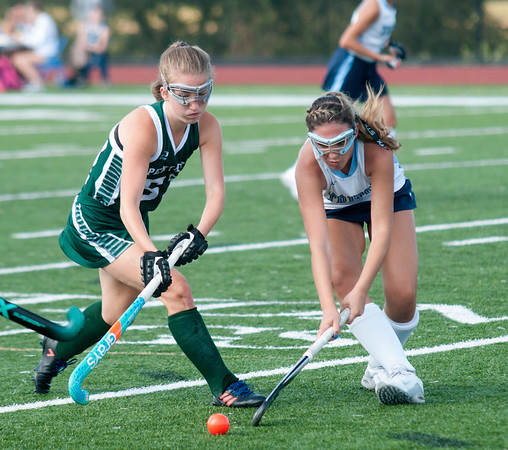JIM VAIKNORAS/Staff photo  Pentucket's Cassidy Brown fights for the ball with Triton's Julia Cordeau during their game at Triton in Byfield Thursday.
