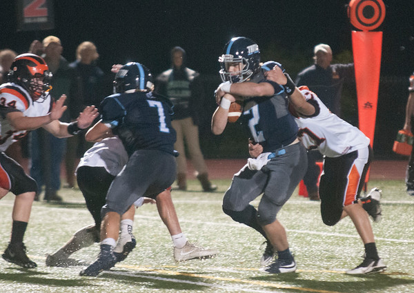 JIM VAIKNORAS/Staff photo Triton's Thomas Lapham fights for yardage against Ipswich Friday night at Triton.