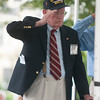 JIM VAIKNORAS/Staff photo  Dick MacCallum of Pease Greeters salutes during the National Anthem at the Field of Honor ceremony on the Bartlet Mall in Newburyport Sunday afternoon.