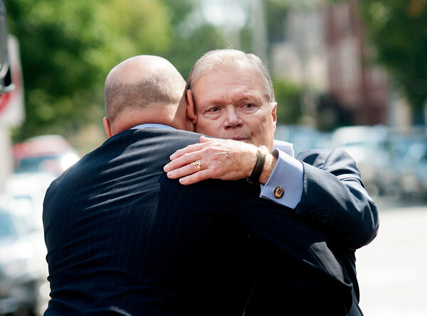 JIM VAIKNORAS/Staff photo 	Jack Bradshaw hugs his son Josh Bradshaw  during a ceremony honoring him in Market Square Saturday. Bradshaw along with Jonathan Woodman were honored for their work in helping restore the Newburyport  in the '70s and '80s.