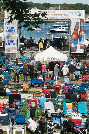 JIM VAIKNORAS/Staff photo Fans fill Market Landing Park for the 16th Annual Newburyport Riverfront Music Festival at Market Landing Park in Newburyport Saturday.