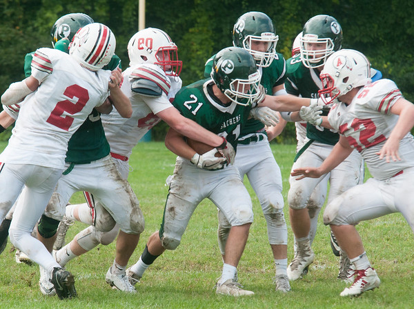 JIM VAIKNORAS/Staff photo Pentucket's Brandon Wilburfight for some tough yards against Amesbury at Pentucket high Saturday.