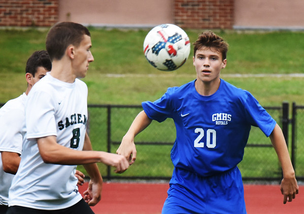 BRYAN EATON/Staff photo. Pentucket's Ryan Gallagher and Georgetown's Aiden Maguire have their eyes on the ball.
