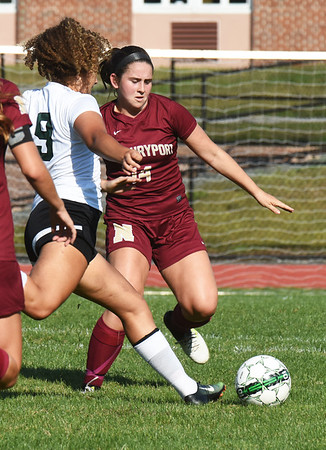 BRYAN EATON/Staff photo. Newburyport's Julia Groth defends against Pentucket's Lilly Queenan.