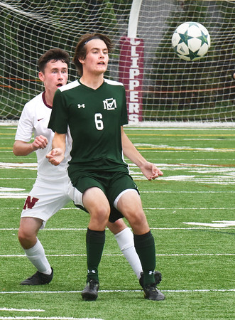 BRYAN EATON/Staff photo. Newburyport's Will Ohlson-Sidford, left, and Addi Strack wait for the ball.