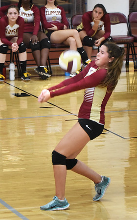 BRYAN EATON/Staff photo. Newburyport's Grace Shelley slides under the ball.