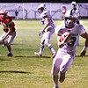 BRYAN EATON/Staff photo. Hamilton-Wenham's Ian Coffey goes in for the touchdown.