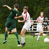 BRYAN EATON/Staff photo. Amesbury's Morgan Holmes and a North Reading player clashed trying to head the ball.