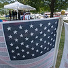 JIM VAIKNORAS/Staff photo A pair of flags containing the names of those killed on 9/11 at the Field of Honor ceremony on the Bartlet Mall Sunday.