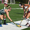 BRYAN EATON/Staff photo. Pentucket's Janet DIckens and Newburyport's Vicky Justiniano scramble for a loose ball.