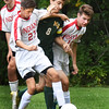 BRYAN EATON/Staff photo. Amesbury's Drew Everett, left, and Michael Gonthier put pressure on a North Reading player.
