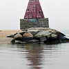 BRYAN EATON/Staff photo. The navigational aid Ben Butler's Toothpick reflected in the water at Salisbury Beach State Reservation one hazy morning earlier this week. The fog may not be there today, but a rain shower or two is forecast, though it's not supposed to be a washout by any means.