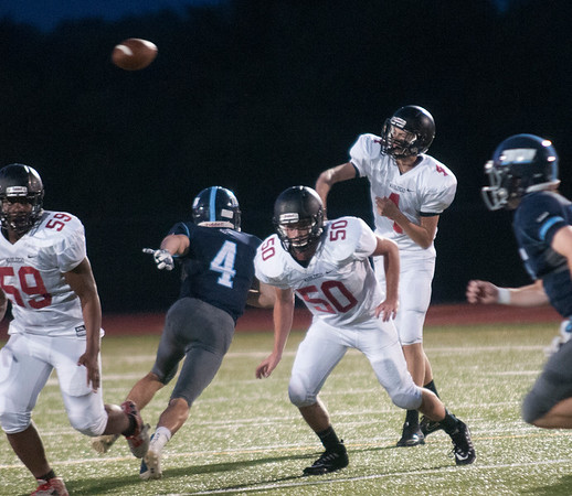JIM VAIKNORAS/Staff photo  Marblehead's Dan Doherty passes the ball Friday at Triton.