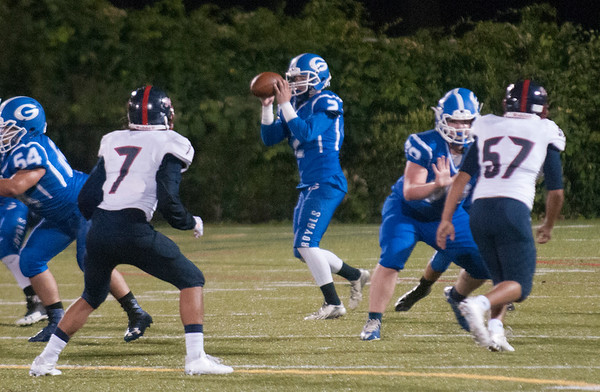 JIM VAIKNORAS/Staff photo Georgetown's Tommy Long looks downfield against Lynn Tech at Georgetown Friday night.